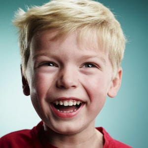 Laughing boy who has received a fluoride treatment as part of our dental services